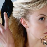 photolibrary_rf_photo_of_woman_brushing_hair