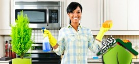 happy-woman-cleaning-kitchen-horiz