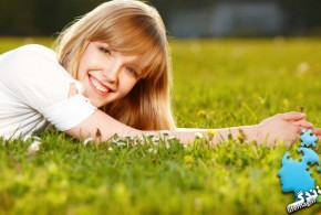 happy-woman-in-grass-660x400