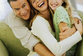 Happy Family Hugging Each Other