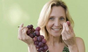 Mature-woman-eating-grapes-556446