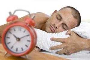 bigstock_Man_Asleep_With_Clock_6535139